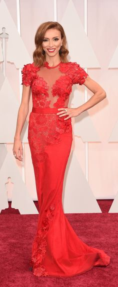 Giuliana Rancic wearing a Mireille Dagher red dress. | Oscars Red Carpet 2015 via Getty Images