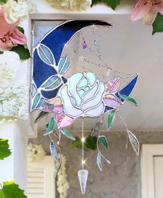 Stained Glass Moon and Rose with Crystals and Webbing. We're stained glass lovers here. Like good design? Get your fill at Referential Treatment. See more stained glass, soldering, church windows, window hangings, and the like like on this board. Stained Glass Projects, Stained Glass Patterns, Stained Glass Art, Mosaic Glass, Decoration Inspiration, Home And Deco, My New Room, Glass Design, Creative