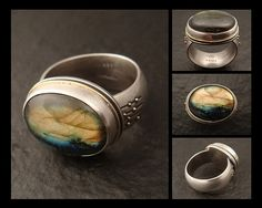 "Another that continues with the marine theme that I have been exploring recently.  This one features a 15 x 19mm labradorite cab with a blue streak on the bottom and a greenish yellow flash on top. The band is a 3/8"" wide low dome sterling silver dec MedallionTradingCompany.com"