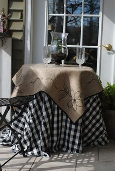rouond table covered with burlap | Burlap over gingham or check