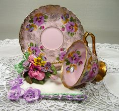Vintage Pink Tea Cup & Saucer with Crocheted Hankie and Velvet Pansies Corsage Gift Set. $50.00, via Etsy.