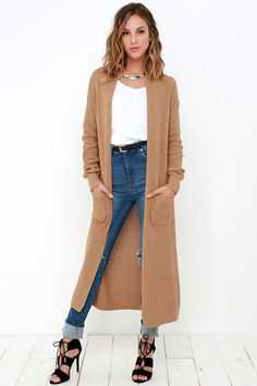 Whether you're lounging at home or out and about running errands, the Portrait Gallery Tan Long Cardigan Sweater is sure to complete your outfit! Cotton-blend knit fabric slopes down a open front finished with patch pockets at the waist. Oversized long sleeves frame the lengthy bodice that ends at a midi-length.
