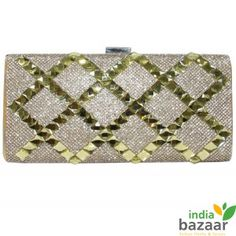 Wear it on your shoulders; hold it in arms or across your body, this glittery party clutch is your perfect party companion in your next social gathering or special occasion. Cultivated with metallic stripes in front and feature with press closure boasts the best classic design in modern era. Golden is the colour of the season, following the trend book your piece order from India Bazaar online store. Dimensions: W20cm x H20cm x D9cm