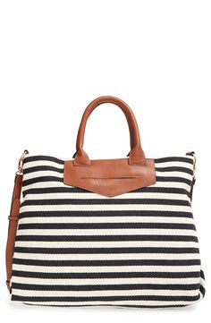 This durable canvas tote in black and white stripes and brown leather gives a trendy nautical feel to the arm candy. It's also perfect for carrying all of the essentials with its deep and roomy interior.
