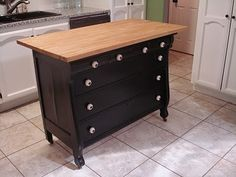repurpose dresser into kitchen island, two to make an L shape then benches and kitchen table inside the L