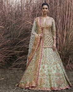 This whimsical pistachio green tulle and silk lehenga is an ode to vintage silhouettes by The piece features a jaal of… Buy Online Designer Collection, :Call/ WhatsApp us 77164 . Pakistani Wedding Dresses, Pakistani Outfits, Indian Dresses, Indian Outfits, Wedding Lehnga, Bollywood Wedding, Indian Lehenga, Silk Lehenga, Bridal Lehenga