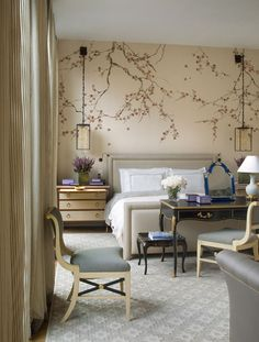 modern home design A desk at the foot of the bed, the hanging lanterns, the gorgeous wallp.