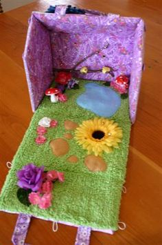 Fairy garden variation on the fabric house.  http://www.craftymamas.net/forum/showthread.php?t=10482