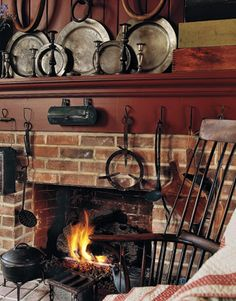 Decorating with American Country Antiques - House Tour - Country Living basement fireplace.  Make decorative
