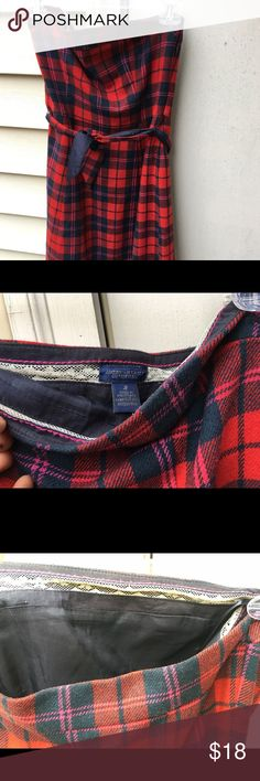 Blue and red plaid mini dress Red and blue plaid mini dress by American Eagle. Tube top with waist belt tie. Perfect for holiday season. Slight discoloration on inside lining but is completely unnoticeable when wearing. American Eagle Outfitters Dresses Mini