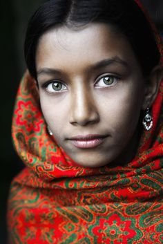 David Lazar. Girl with Green Eyes and Red Headscarf. Taken in Putia, Bangladesh, this portrait features a young lady's green eyes. The story behind this photo: http://davidlazarphoto.com/2012/08/photographing-girl-with-green-eyes-bangladesh/
