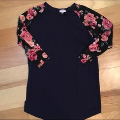 LulaRoe Randy - RARE ;) This stunning and totally fun SMALL Randy fits a 6-8 great. Navy torso and black floral sleeves. Amazing condition. ASK QUESTIONS BEFORE BUYING. LuLaRoe Tops