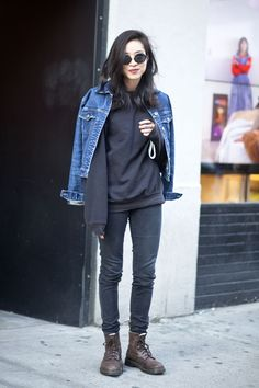 Denim jacket + black sweatshirt + black skinny jeans + brown lace-up boots