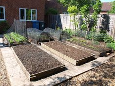 Just put in two raised beds in my garden. Nothing as professional as these but a start!