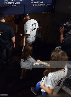 Alex Rodriguez #13 of the New York Yankees walks into the clubhouse with his daughters Natasha and Ella after the game against the Tampa Bay Rays at Yankee Stadium on August 12, 2016 in New York City.