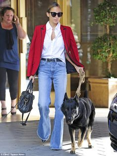 Nicole Ritchie...Effortless: The mother-of-two looked effortlessly chic and not to mention super slim in the denim trousers, which she teamed with an unbutto...