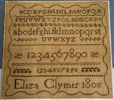 """Alphabet sampler, Eliza Clymer, 1805, dark brown on light brown ground, scalloped border, an """"E"""" in light blue outside the border below the name, stitched to a linen backing stretched over a stiff board, 11 1/4"""" x 12 1/4"""", unframed"""