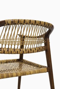 Rastad & Relling Bambi armchair in teak and cane at Studio Schalling