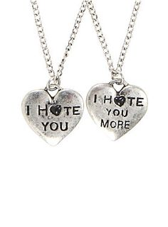 """<p>There's a very thin line between love and hate. You know you're super close when you can tell your bestie you hate themand they just get it. Silver tone necklace set with hearts that say """"I Hate You"""" and """"I Hate You More."""" Perfect for the ultimate frenemies.</p>  <ul> <li>Chains: 18 1/2"""" long with a 3"""" extender</li> <li>Pendant: 1""""</li> <li>Alloy</li> <li>Imported</li> </ul>"""