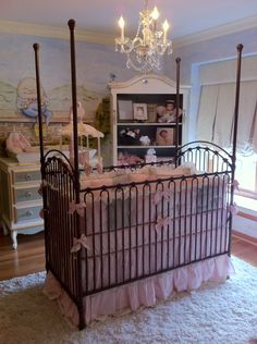 Classic French Nursery. I kinda like the crib out in the middle of the room, it's unusual, but cute until they can crawl out