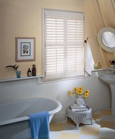 Shutters are perfect for bathrooms! Photo courtesy of Budget Blinds.plus wrap around shelf Types Of Window Treatments, Kitchen Window Treatments, Custom Window Treatments, Interior Window Shutters, Vinyl Shutters, Indoor Shutters, House Blinds, Blinds For Windows, Arched Windows
