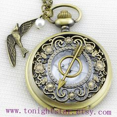 The Hunger Games Pocket Watch Necklace by tonightstar on Etsy, $7.99    So cool i want it !!!