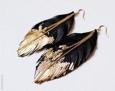 cut leather to leafs shape with slits on the sides to look feather like. brush lightly with gold paint and then dry. attach earing hook and gold chain