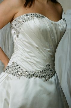 This dress is stunning! Satin ballgown with exquisite crystal beadwork.