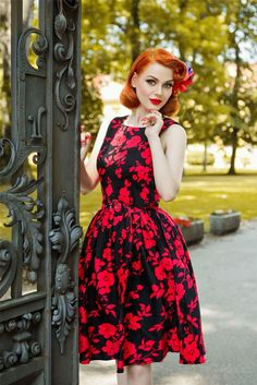 318229892d1aee This gorgeous pin up girl style dress has been cut to compliment your  curves! The