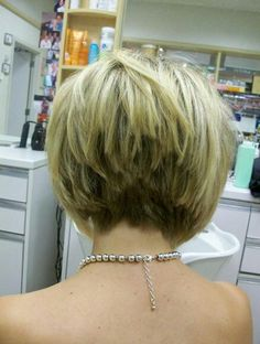 Short bob haircut with angled choppy look in back.