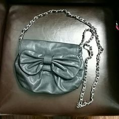 Black purse Black faux leather purse. Bow on the front, silver & black chain strap. Gray leopard print interior. Bags