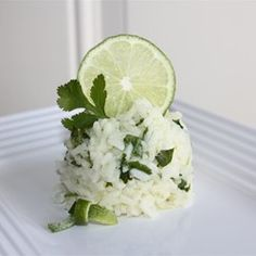 Boil the rice in 1c of water, 1c of chicken stock and 1tsp of salt for  17mins, remove from heat, remove lid and put a dish towel on top and return lid and allow it to sit for about 10min (this makes sure the rice is fluffy because the towel absorbs the excess steam). Then stir in cilantro and fresh lime juice to taste...for my family its usually 1 to 1.5 limes.