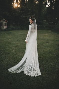 Chloe by Rue De Seine is a beautiful bohemian inspired cotton long sleeve wedding dress covered in stunning, intricate floral embroidery.
