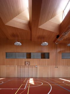 School Complex in Chermignon / Frei Rezakhanlou Architects, wood gym, skylights