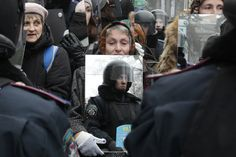 FACE TO FACE: A demonstrator held a mirror to reflect police officers in Kiev, Ukraine, Monday. Opposition activists protested in the capital, continuing more than a month of rallies opposing the government's decision to shelve a key deal with the European Union. (Sergei Chuzavkov/Associated Press)
