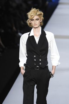 Christian Dior Spring 2008 / top is inspired by a shirtwaist blouse / cut like a men's shirt, except for the leg of mutton sleeves.