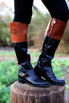 Just bought these etienne aigner chastity two tone black/brown riding boots! I'm in love.