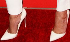 """Chrissy channels a white winter in a pair of Christian Louboutin """"Iriza"""" pumps"""