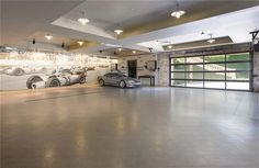 Dream Garage in Dallas mansion - Now, what cars would you fill it with, since budget is obviously not a problem? : Dream Garage in Dallas mansion - Now, what cars would you fill it with, since budget is obviously not a problem? Garage Office, Car Garage, Garages, Garage Design, House Design, Mansion Homes, Barn Homes, Garage Systems, Warehouse Living