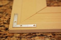 DIY Frame with moulding and L brackets