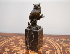 owl standing on a branch bronze signed  Bronze by WooodLand