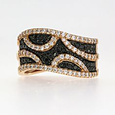 .74cts of black and white round brilliant cut diamonds. These diamonds are prong set in a 14k rose gold mounting.