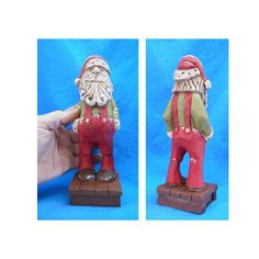 This Santa Claus is carved from basswood and is intricately hand-painted to enhance details. Jolly old St. Nick is back home for the holidays . Details: Measures: 3 x 3 x 9 h Hand Carved: solid wood Material: bass wood One Piece Woodcarving