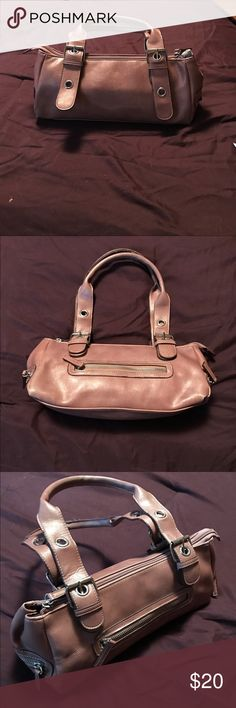 "Casual brown handbag This great handbag is a faux leather ( no tag to indicate that it is made of real leather ) has a matching brown lining. The hardware is white metal straps are adjustable using belt type closure. Can be adjusted to 14"" and 17 1/2"". Outside of purse has shallow zippered pockets on each side and across the back. Inside has zippered pocket and 2 fabric pockets to keep your cell, lipstick or gum in easy reach. Measures 11""W x 5 1/2""H x 4""D. Aldo Bags Satchels"