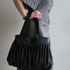 This is new version of my large pleated handbag which has always been one of peoples favorites. I crafted this handbag from ultra suede (man made