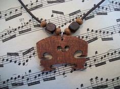 Hey, I found this really awesome Etsy listing at https://www.etsy.com/listing/79974895/violin-bridge-necklace