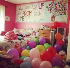 "Get balloons and put them in her room. Then hang a sign saying ""Will you fly up to prom with me?"""