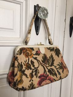 A personal favorite from my Etsy shop https://www.etsy.com/listing/276860482/vintage-1950s-tapestry-floral-carpet-bag