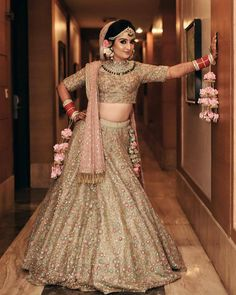 Can't decide what we love more about her look - her beautiful ivory lehenga with pink undertones, her customized kaleeras bringing an edge… Golden Bridal Lehenga, Sabyasachi Lehenga Bridal, Lehenga Choli Wedding, Indian Bridal Lehenga, Wedding Lehanga, Bollywood Lehenga, Pakistani Bridal, Indian Bridal Outfits, Indian Dresses
