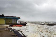 The storm surge from Hurricane Sandy beats against a beachside building in Shinnecock Hills, New York